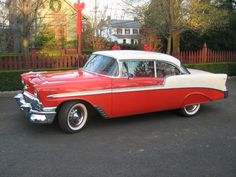 1956 Chevy. Had a yellow and black one like this.  Florida cancer (rust) got it.
