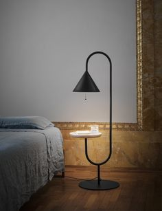 The Ozz lamp is composed of two elements in harmony - a small tray, with a suspended light above reminiscent of a tuning fork. Design by with for Italian Furniture Brands, Floor Lamp With Shelves, Small Coffee Table, Coffee Tables, Shelf Design, Contemporary Furniture, Desk Lamp, Wall Lamps, Decoration