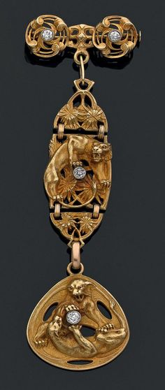 An antique 18k gold and diamond brooch, terminating with a medal depicting cats playing, monogrammed PB on reverse, circa 1912.