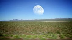 Stock Footage | Driving through the desert with the full moon in the distance. | Download using the VidLib app. 50.000 Royalty Free Clips'