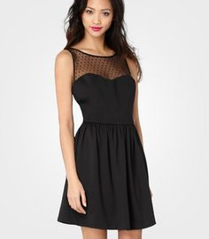Black mini dress. Love the sheer top