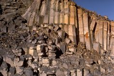 The vertical columns in this basalt flow form by cooling of the flow, which causes the flow to shrink, which in turn causes vertical fractures (joints) to form.