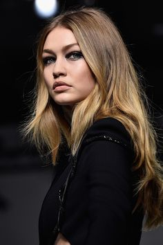 VERSACE At Versace, dark smoky eyes were set against radiant skin and undone hair. Donatella Versace wanted to emphase each model's individuality, so it was about enhancing natural beauty rather than a uniformed look.   - HarpersBAZAAR.co.uk