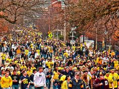 Crowd walking down to the Big House on a Saturday afternoon