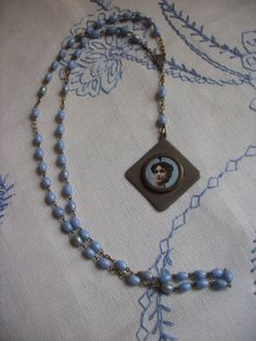 Altered Rosary Pendant by BelarouciDesigns on Etsy, $40.00