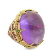 18K Gold and Sterling Silver Aria Ring 18 Karat gold and sterling silver ring with center cabochon amethyst, side rubies and tsavorites $4,700.00 Approx £3,000