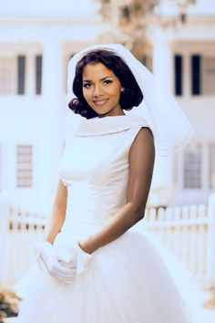 34 Of The Most Memorable Wedding Dresses In TV History #refinery29  http://www.refinery29.com/2015/09/93917/best-tv-show-wedding-dresses#slide-20  Shelby Cole, The WeddingHalle Berry donned a sweet retro look for this 1998 miniseries. Love the gloves, babe....