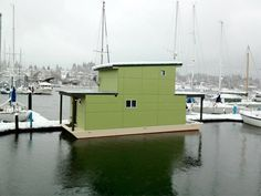 """Sweet Pea, built and designed by Mike Auderer of Olympia Construction, is a 550-square-foot houseboat (located in Olympia, Washington)."""