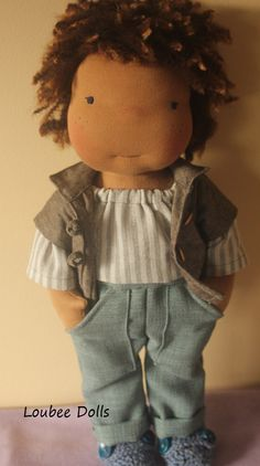 This doll is completely hand made by me and stands 16 tall . He has a mocha skin tone, black eyes and brown hair .    Dougie is stuffed with pure