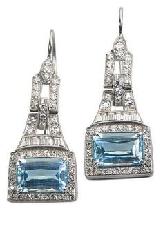 """ART DECO DIAMOND AQUAMARINE PLATINUM EARRINGS Bead set single and channels of baguette cut diamonds frame scissor cut aquamarines in millegrained platinum, melee approx. 1.4 cts., ca. 1930. Drop 1"""". 5.2 dwt. Property from the collection of Gray Davis Boone."""