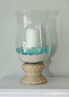 a Seaside Retreat (in your home) + Giveaway! Rattan Hurricane - fill it with sand and seaglass for a fabulous coastal look!Rattan Hurricane - fill it with sand and seaglass for a fabulous coastal look! Hamptons Decor, Seaside Decor, Beach House Decor, Coastal Decor, Home Decor, Coastal Entryway, Coastal Interior, Coastal Furniture, Decor Crafts