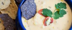 Perfect for game day and potlucks, this creamy queso recipe is chock full of roasted corn, tomatoes and garlic. Ready in under an hour, serve the dip warm with your favorite chips.