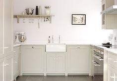 deVOL Shaker Kitchen in a beautiful renovated barn.  Muted painted cabinets, white farmhouse sink, open shelving.