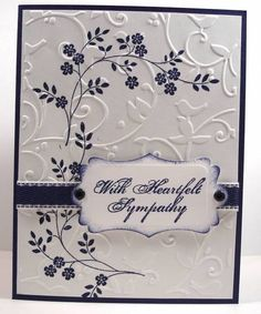 "By NanaDiana at Splitcoaststampers. Uses stamp from Stampin' Up ""Thoughts and Prayers"" stamp set. First, stamp the flowers. Then dry-emboss white cardstock panel with Cuttlebug ""Birds and Swirls"" embossing folder. Add ribbon and sentiment. (Her sentiment was inked on a die-cut with sponged edges.) Attach to card base."