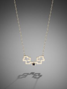 A unique design, this delicate pendant is inspired by Art Deco and traditional lattice decoration. The onyx stone at the centre makes it more precious. Pair with the Tattoo Cuff and Tattoo Necklace.   Material: 100% brass and onyx stone  Colour(s): available in gold only  Dimension:  (necklace) 40cm - 41.5cm and (pendant) 5cm x 2.3cm   Ref: 5G101L2