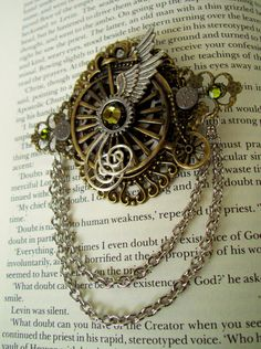 Steampunk Brooch (Pin136) - Winged Bicycle - Brass Chains - Swarovski Crystals. $38.00, via Etsy.