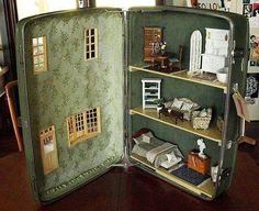 Suitcase made into a dollhouse.