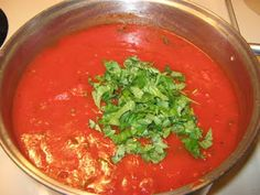 Homemade spaghetti sauce   substitute canned tomatoes for garden tomatoes, can or freeze