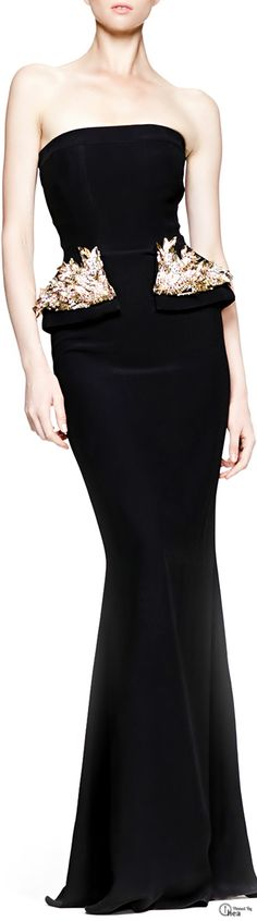 Lovely spin on an otherwise plain black strapless gown, the golden detailed peplum. Very pretty and sophisticated.