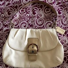 Coach White & Gold Purse Coach White & Gold Purse  Condition - Used with love!  