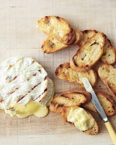 Grilled Cheese Wheel - Martha Stewart Food - Choose a wheel of cheese with a thick rind and an inside that's soft but not runny, such as Camembert. Brush rind with olive oil, and grill cheese directly on oiled grates over indirect heat until warmed, about 2 minutes per side. Serve immediately with grilled baguette slices.