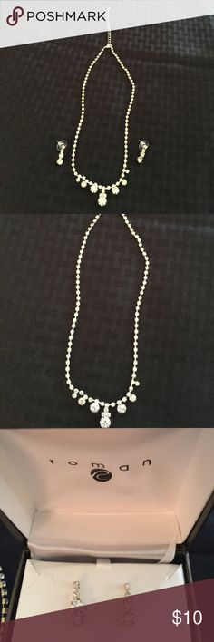 "Jewelry Necklace & earrings (costume jewelry) silver tone... never worn NWT ... rhinestones ....perfect for prom! Necklace is 18"" plus 2"" chain. Earrings are about an inch long. roman Jewelry Necklaces"