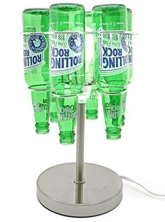 An imaginative and responsible way to reuse and recycle your favorite glass bottles, these recycled lamps give off a glow that truly reflects your taste. Fits most glass bottles and uses a standa . Cutting Glass Bottles, Recycled Glass Bottles, Glass Bottle Crafts, Recycled Lamp, Recycling, Glass Artwork, Corporate Gifts, Lamp Design, Mason Jars