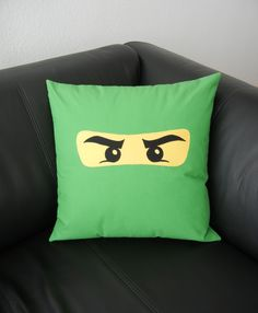 my project: ninjago pillow - inspired by this tutorial http://ontopofalilypad.blogspot.de/2012/06/ninja-pillows.html . I took a pic of a lego-box, enlarged the eye part of the masque, cut the outline from yellow fabric, traced the eyes onto steam-a-seam and used black fabric to then machine appliqué it all with a very small zig-zag stitche onto green fabric. used this tutorial http://www.houseonhillroad.com/photos/put_a_zipper_in_your_pill/ to make a lapped zipper closure (worked a treat!)