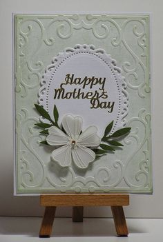 Cathys Card Spot: Layered Mother's Day. The embossing folder is Rebecca (Cuttlebug), the oval die is Spellbinders and the flower is embossed on vellum.