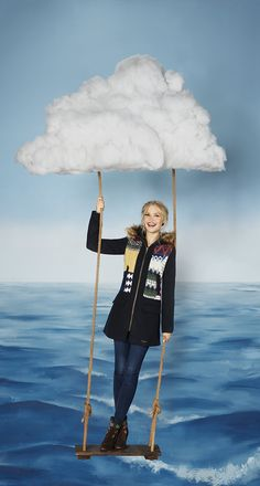 In Desigual´s oniric universe it is posible to find someone hanging from the clouds. Don´t you believe us? Check our model, Camilla Christensen, wearing one of the designs of our Coat-llection over the sea.