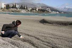 Spewed by Chile's Puyehue volcano, ash blankets the Nahuel Huapi lakeshore in Bariloche, Argentina