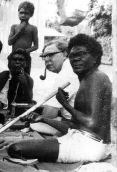 Ronald Berndt seated with Buramara, Elcho Island, recording a song cycle