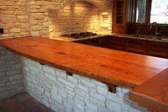 """Texas mesquite bar top.  A great change from the standard """"everybody has"""" granite."""