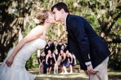 This fun shot focused on the bride and groom but still includes the entire wedding party. Hilton Head Island, SC. Best Wedding Photographer, Bluffton Today, 2012 and 2013.
