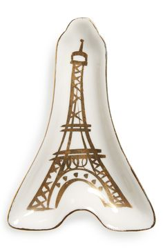 Collecting the jewelry, change and other odds and ends in this ultra-chic Eiffel Tower trinket tray that adds a touch of French sophistication to the décor.
