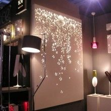 DIY Canvas light up wall art. Use any canvas, apply stickers, decals, etc., and spray paint. Remove the Decals; hang white lights behind it and voila.