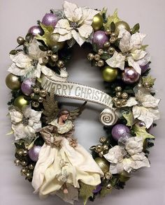 Oval Christmas wreath with floristry in pastel shades of lilac and mint green. Christmas Mesh Wreaths, Christmas Swags, Handmade Christmas Decorations, Elegant Christmas, Christmas Door, Outdoor Christmas, Christmas Angels, All Things Christmas, Christmas Crafts