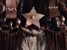 Star badge on a Little Big Bonnie bag. Custom hair on hide bags at gowestdesigns.us