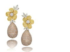 A pair of coloured diamond and diamond pendent earrings Designed as a flowerhead, set to the center with brilliant-cut diamonds, surrounded by petals pavé-set with similarly cut diamonds of yellow hue, highlighted by marquise-cut diamond leaves, to a drop set with brilliant-cut diamonds of pink hue, mounted in 18k white, yellow and pink gold.