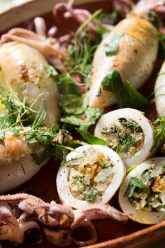 Squid (or calamari, its Italian name) can be prepared in a variety of ways — fried, braised, grilled and roasted — and all are good In this recipe whole squid are stuffed before roasting with a bread crumb filling that contains typical Sicilian ingredients like chard, fennel, anchovy, pecorino and pine nuts.