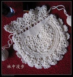 filet crochet bag. this might be nice for a wedding or for a child to go with a special dress for xmas or Easter