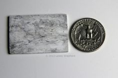 Use this faux marble paint technique to make countertops, tiles and other marble objects in miniature scales.
