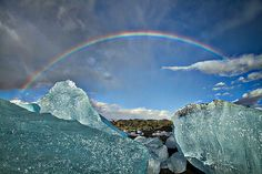Photograph by Stuart Litoff.  A #rainbow frames #icebergs at #Jokulsarlon #beach in #Iceland