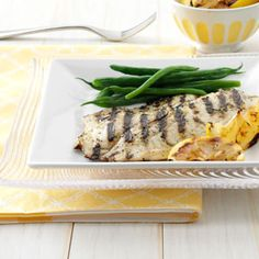 Grilled Greek Fish Recipe _ Living in Tampa, we eat a lot of fresh fish, mostly grouper, mahi-mahi and Tilapia—all sweet white fish that work well with this marinade.