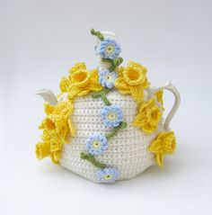 Crochet tea cosy Spring flowers teapot cozy floral cosies crocheted cottage chic kitsch cozy with daffodils and forget me nots. £35.00, via Etsy.