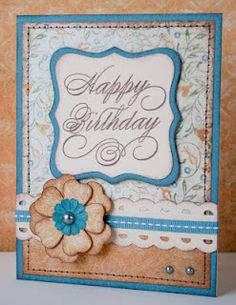 I love this paper.  Don't know which flower I would use with this, but it's a beautiful card!