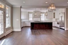 """Like paint and open concept and flooring throughout the space Sherwin Williams """"Agreeable Gray"""" Dark Wood Floors, Grey Flooring, Kitchen Flooring, Kitchen Wood, Kitchen Ideas, Kitchen Cabinets, Wood Beams, Gray Cabinets, Design Kitchen"""