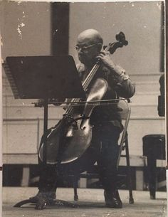 """Original photo by famous photographer Gaby Demarais of the greatest cellist Pablo Casals. The photo size is 19.75"""" H x 15"""" W. Unframed and mounted. Original signature in ink by Gaby Desmarais on the lower right corner."""