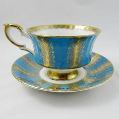 Paragon tea cup and saucer, blue with gold decoration. Flowers on inside rim of tea cup and in center of saucer. Gold trimming and ribbing on teacup and saucer. Excellent condition (see photos). Paragon started as the Star China Company in 1897, founded by Hugh Irving and Herbert Aynsley