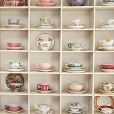 my dream house will have one of these shelving units for tea cups...and another for shoes!